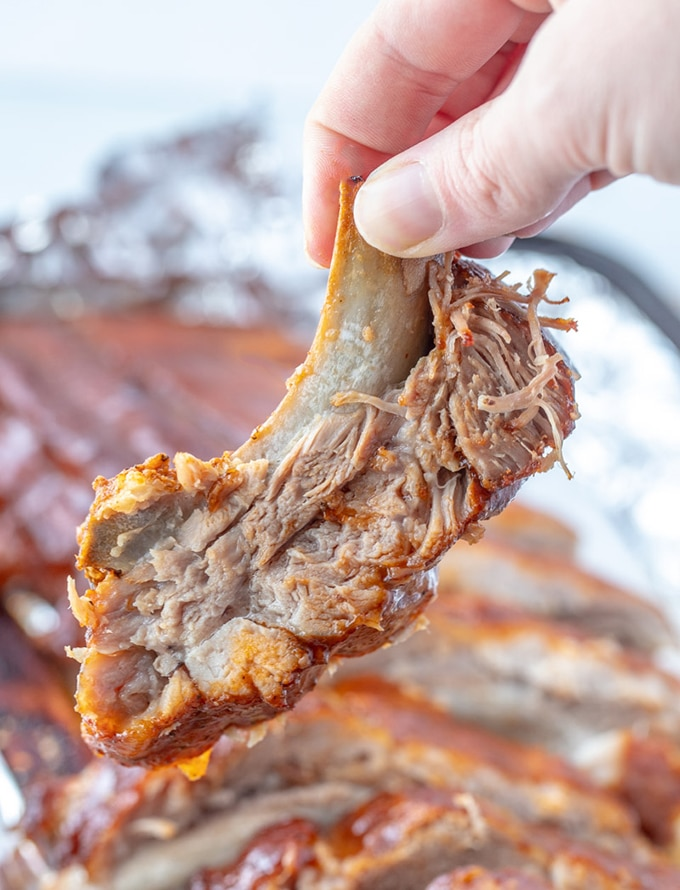 holding Instant Pot BBQ rib with fingers