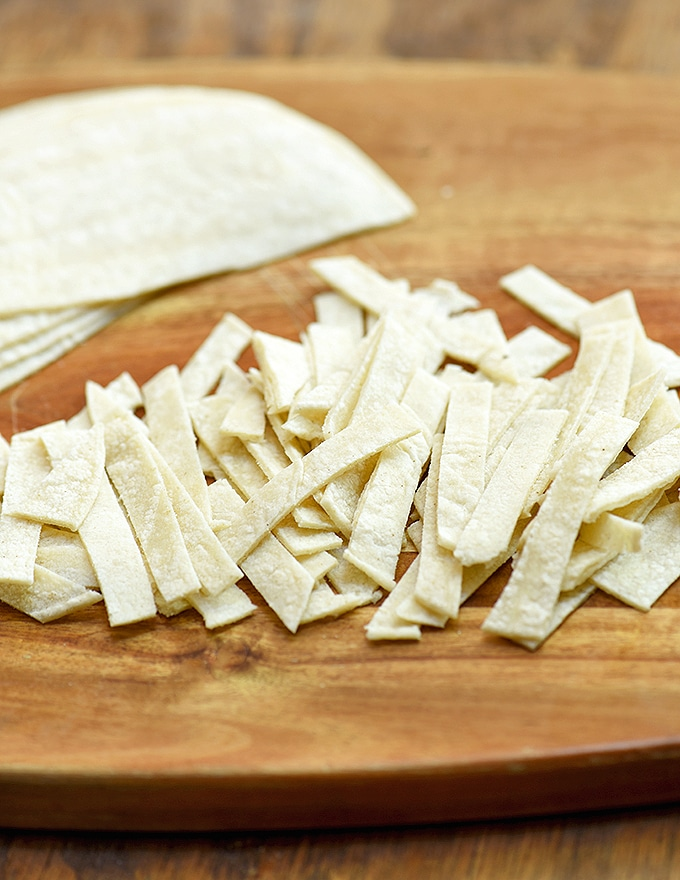 corn tortilla strips ready to fry for chicken tortilla soup