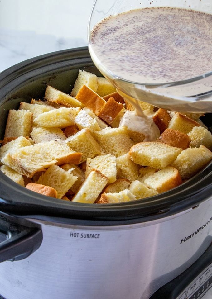 pour egg-milk mixture on cut up bread in the crockpot