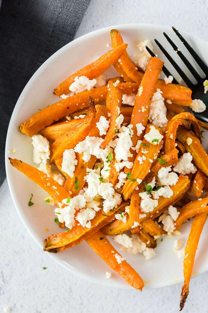 Air Fryer-Roasted Curry Carrots with Feta Cheese on a white plate