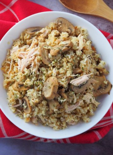 Instant Pot Chicken and Rice with mushrooms on a white plate