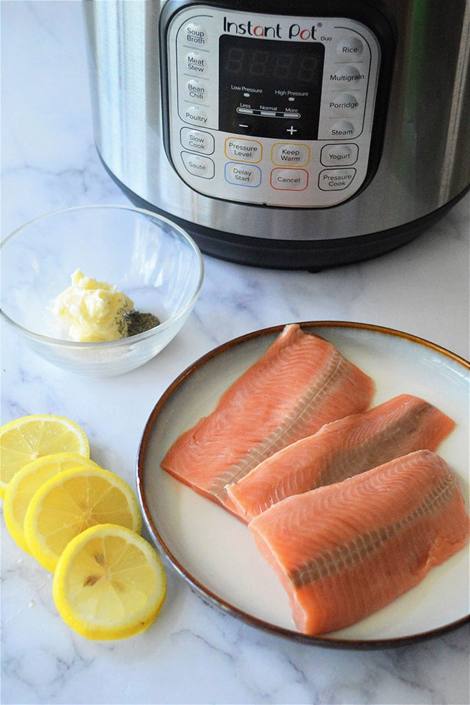 salmon fillets, sliced lemon, butter, dill, and Instant Pot