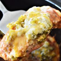 serving cheesy enchilada chicken from the slow cooker