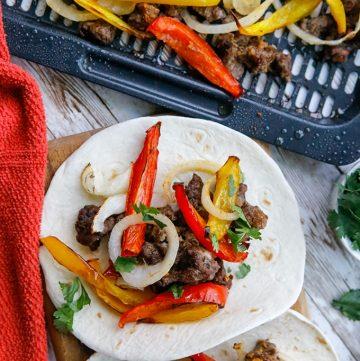 Air Fryer Steak Fajitas with bell peppers on flour tortilla