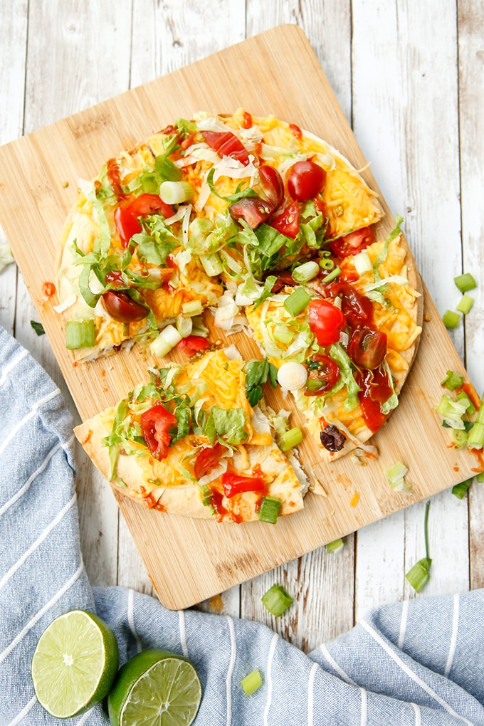 sliced Mexican pizza on a cutting board