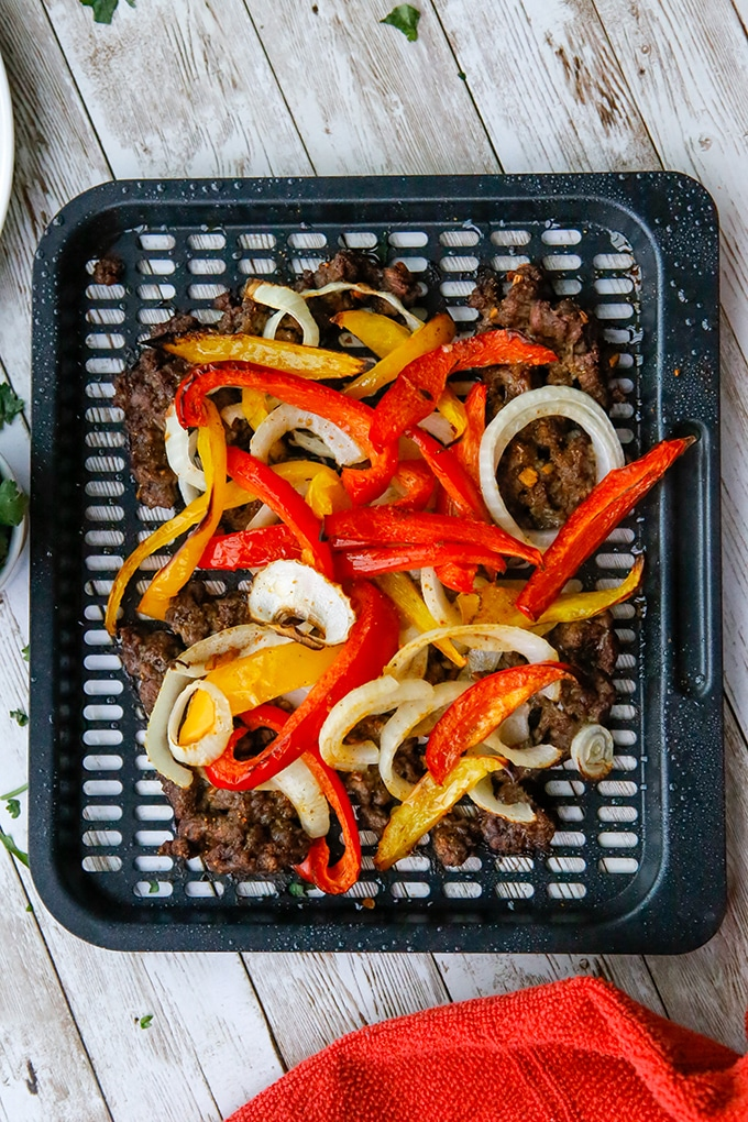 beef fajitas cooked in the air fryer with bell peppers and onions