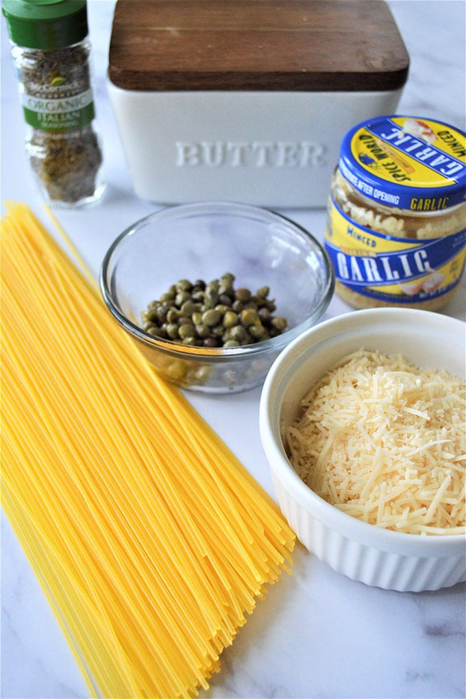 spaghetti, capers, garlic, Parmesan cheese, container of butter