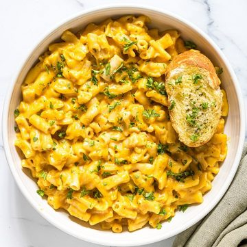 pressure cooker pumpkin macaroni and cheese in a white bowl