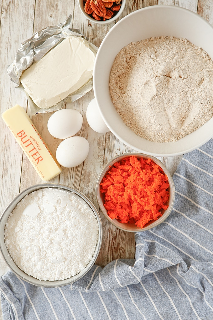 spice cake mix in a bowl, butter, eggs, shredded carrots, cream cheese