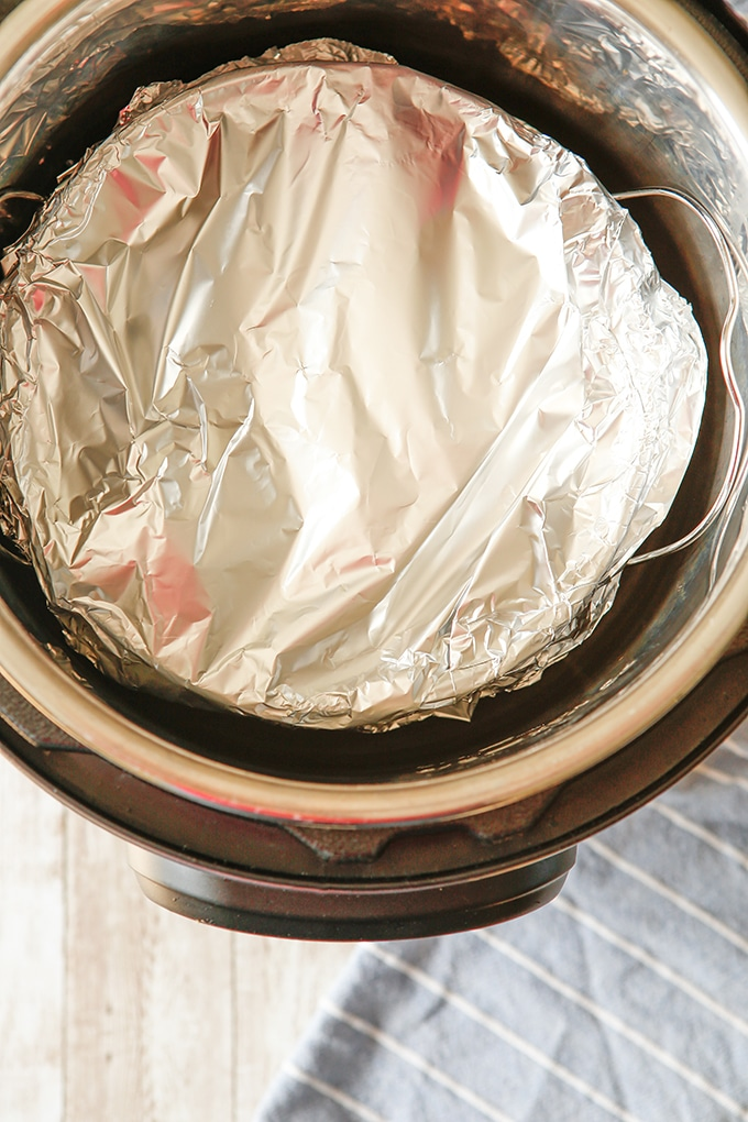 cake pan wrapped in foil in the Instant Pot
