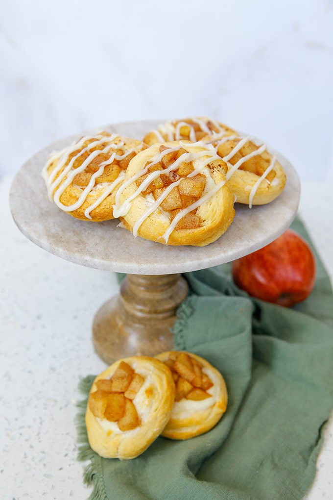 Apple Danishes on a cake pedestal