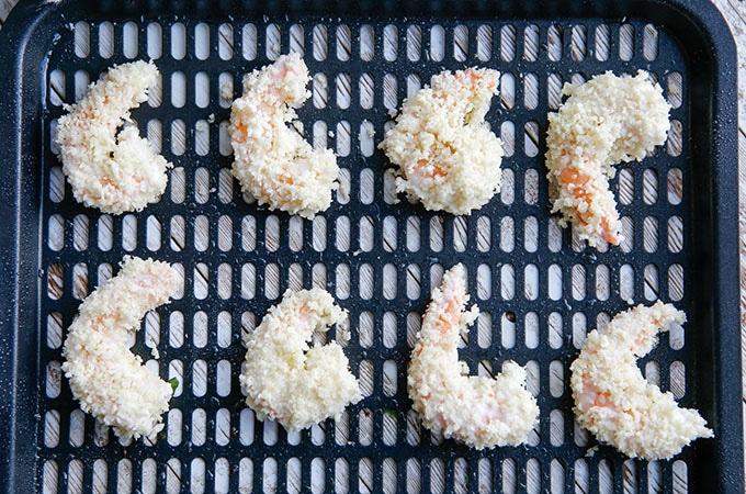 panko-coated shrimp on an air fryer rack