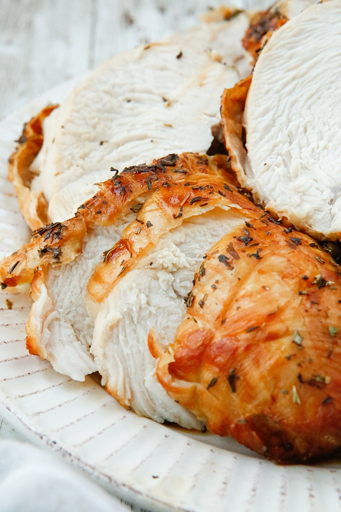 sliced Air Fryer Herbed Turkey Breast on a white plate