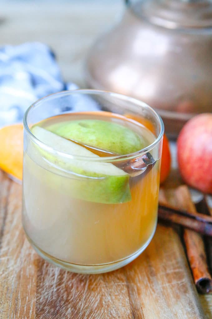 pressure cooker apple cider in a clear cup