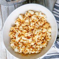 Instant Pot Caramel Popcorn in white bowl