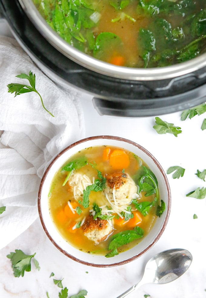 pressure cooker Italian wedding soup in a bowl with Instant Pot on the side